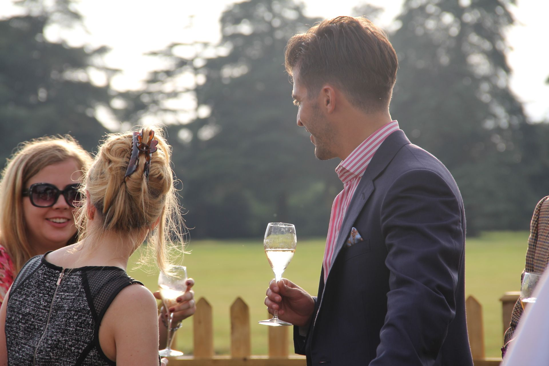 Guests with Nyetimber in hand